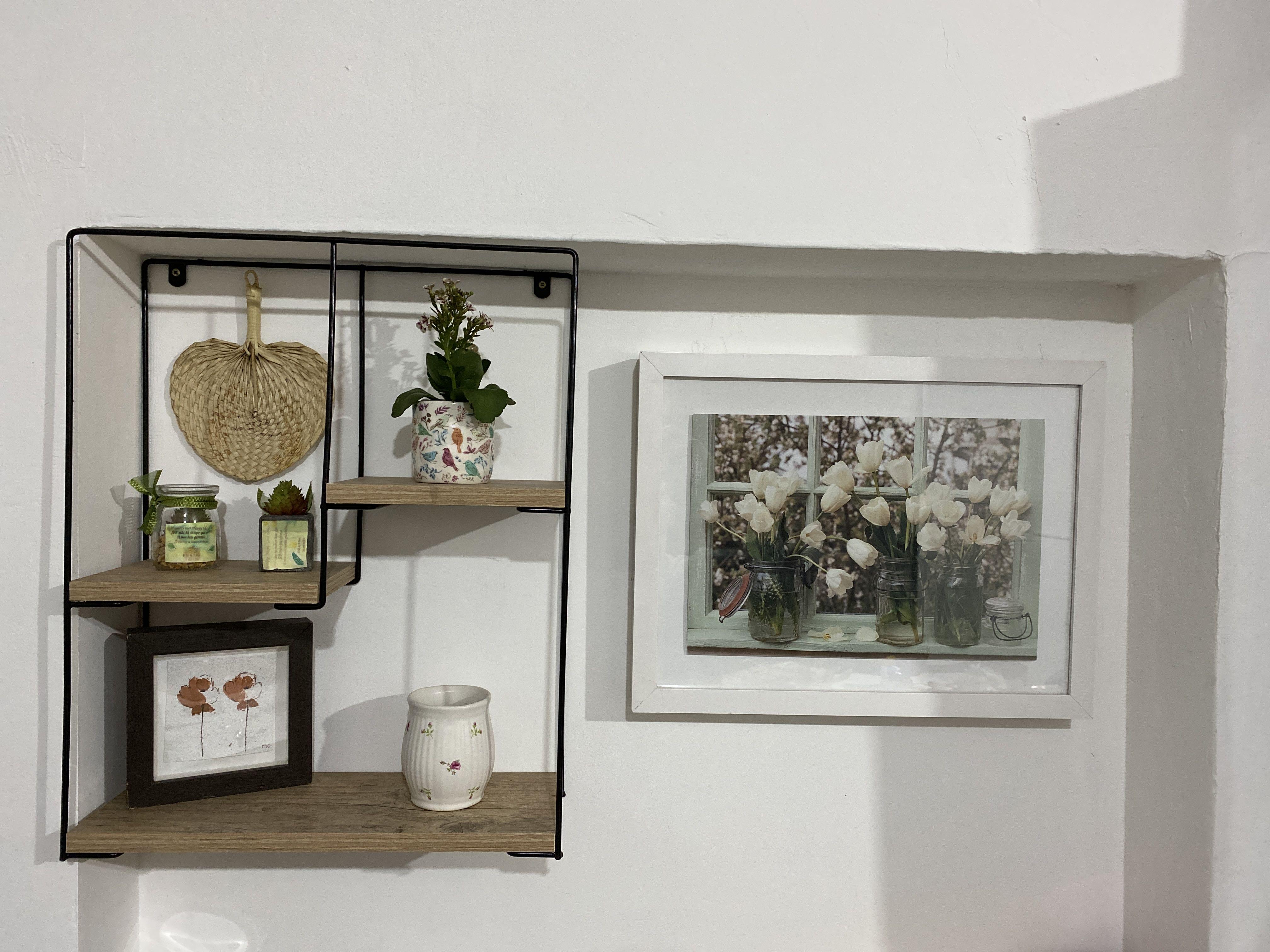 Instalação de nichos, prateleiras e quadros.