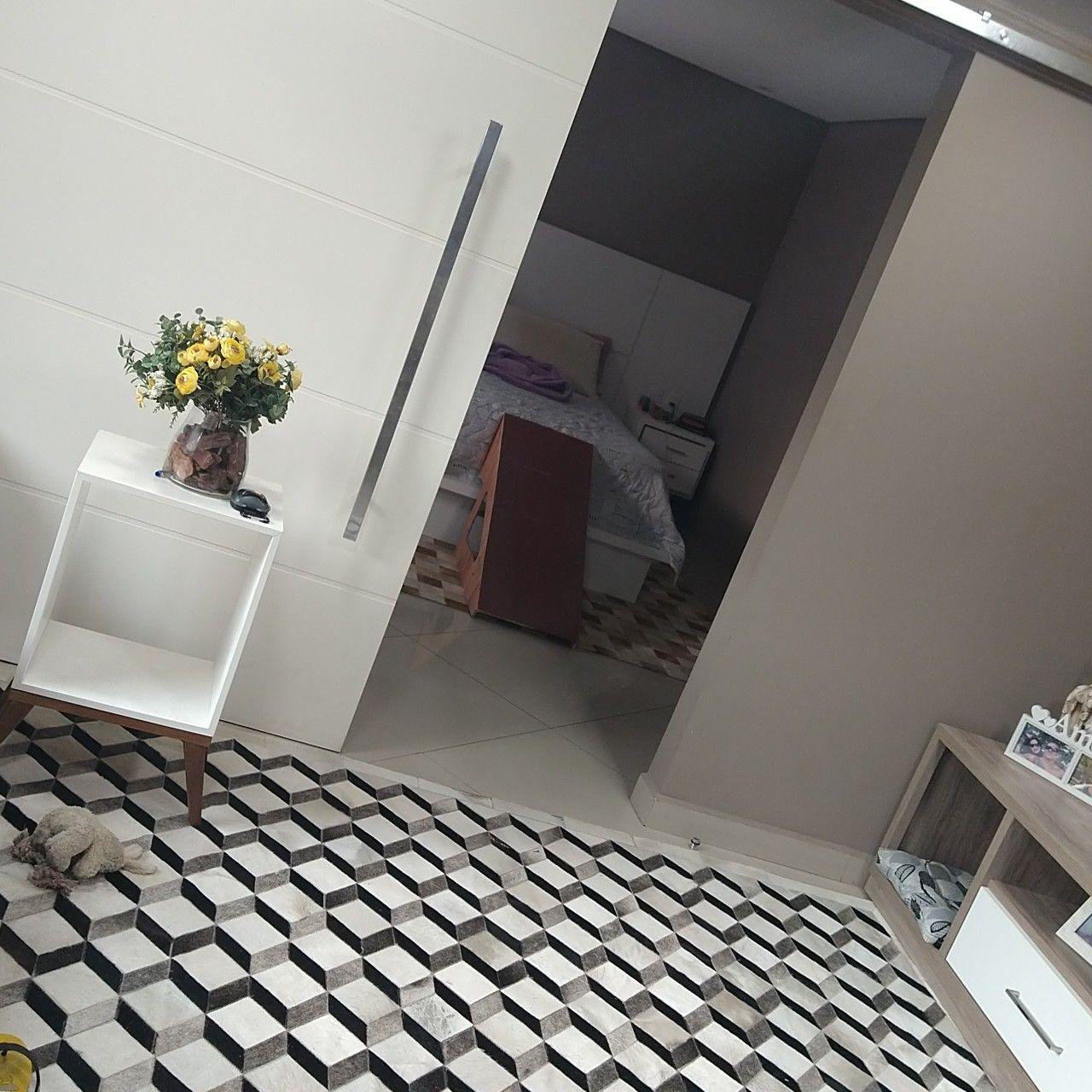 casa com tapete