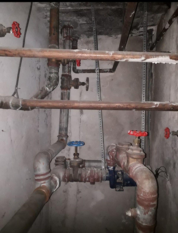 encanamento de caixa d'água predial e comercial