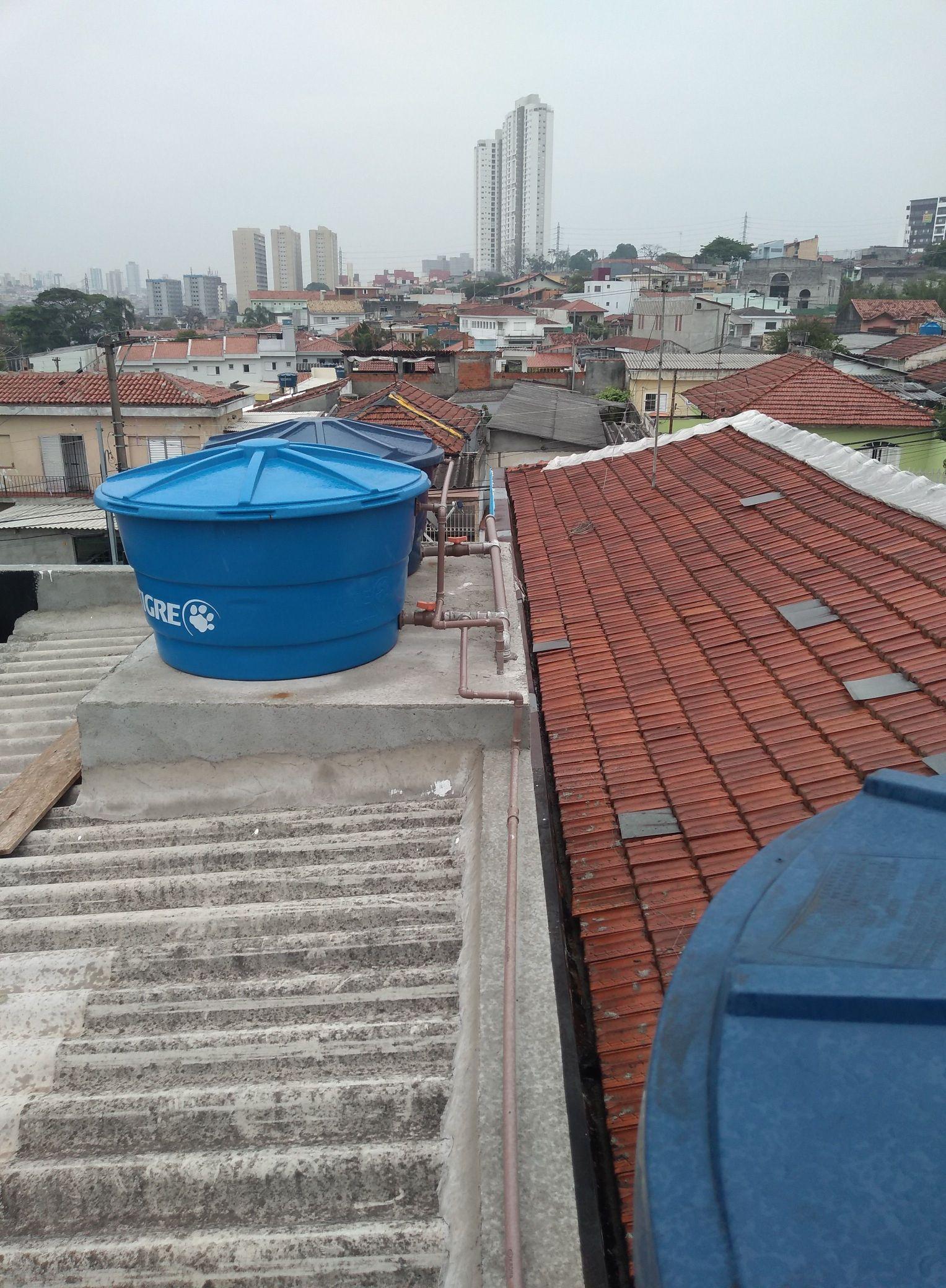 instalação de nova caixa d'água