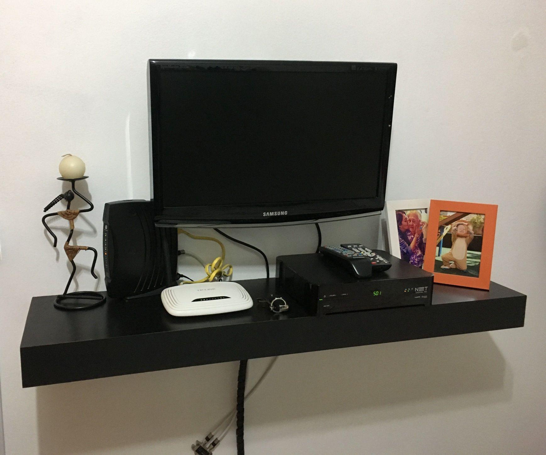 Instalação de TV e prateleira para equipamento