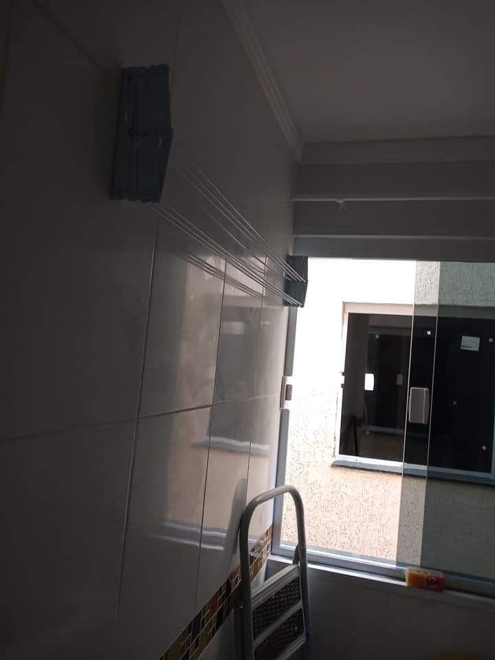 instalação de varal de teto e varão de cortina